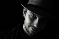 Young man`s portrait in the dark Stock Photos