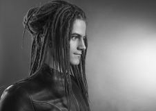 Young man's portrait. Stylish handsome sexy Guy with Dreadlocks Stock Images