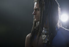 Young man's portrait. Stylish handsome sexy Guy with Dreadlocks Royalty Free Stock Image