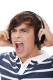 Young man's singing with headphones. Royalty Free Stock Photography