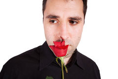 Young man sad with red rose Stock Image