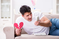 The young man in sad saint valentine concept Stock Photography