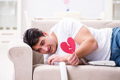 The young man in sad saint valentine concept Stock Photos