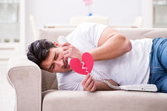 The young man in sad saint valentine concept Stock Photo