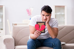 The young man in sad saint valentine concept Royalty Free Stock Images