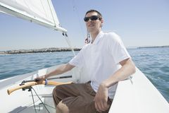 Young Man Sailing Stock Images
