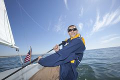 Young Man Sailing Stock Image