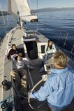 Young man sailing boat Stock Image