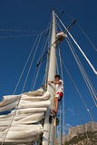 Young man on sailing ship, active lifestyle, summer sport concept Stock Photos