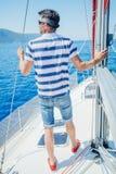 Young man sailing yacht. Sail vacation. People holidays travel stock image