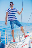 Young man sailing yacht Royalty Free Stock Images
