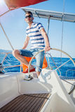 Young man sailing yacht. Steering wheel vacation sail holidays people travel Royalty Free Stock Photography