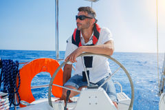 Young man sailing yacht Royalty Free Stock Photo
