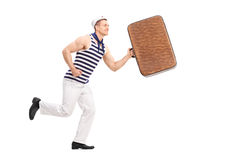 Young man in a sailor clothes  running Royalty Free Stock Photo