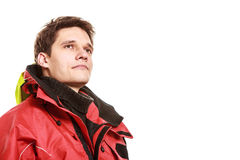 Young man sailor in red wind jacket. Sailing. Young man sailor wearing red waterproof wind jacket with copy space blank isolated on white. Sailing yachting Royalty Free Stock Photo