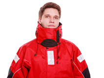Young man sailor in red wind jacket. Sailing. Stock Image