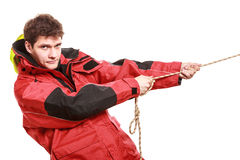Young man sailor in red wind jacket. Sailing. Stock Photography
