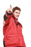 Young man sailor in red wind jacket. Sailing. Stock Photo