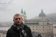 Young man in the Salzburg town. Travel and discover Stock Photography