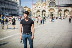 Young Man in San Marco Square in Venice, Italy Royalty Free Stock Photography