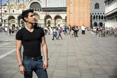 Young Man in San Marco Square in Venice, Italy Royalty Free Stock Photo