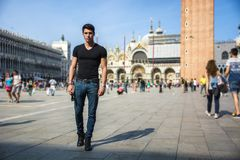 Young Man in San Marco Square in Venice, Italy Royalty Free Stock Image