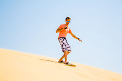 Young man sand boarding Stock Photo