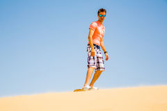 Young man sand boarding Stock Images