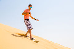 Young man sand boarding Royalty Free Stock Images