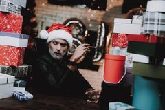 Young Man in Santa Claus Cap with Gift Boxes. royalty free stock photos