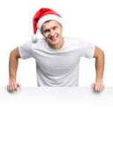 Young man in a Santa Claus hat Royalty Free Stock Image