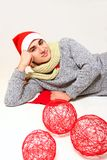 Young man in a Santa Claus hat with red balls isolated on white Royalty Free Stock Photos