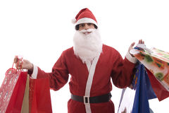 Young Man in Santa costume, full of gifts Royalty Free Stock Photography