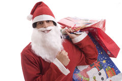 Young Man in Santa costume, full of gifts Stock Images