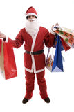 Young Man in Santa costume, full of gifts Stock Photo