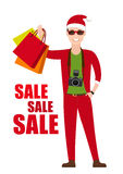 Young Man In Santa Costume with shopping bags in Stock Images