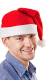 Young man in a Santa hat Stock Images