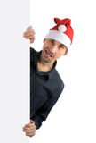 Young man in a Santa hat Royalty Free Stock Photography