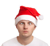 Young man in santa hat with crossed eyes Stock Photo