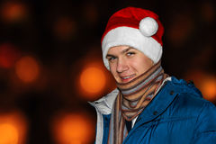 The young man in a Santa hat Royalty Free Stock Image