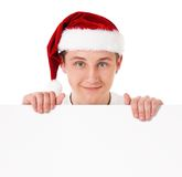 Young man in Santa hat Royalty Free Stock Image
