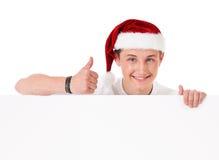 Young man in Santa hat Royalty Free Stock Photos