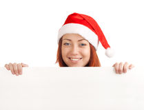 Young man in santa hat holding a blank sign Stock Photos