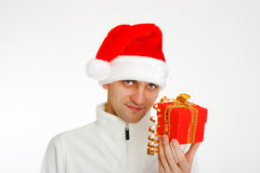 Young man in a Santa hat holding gift Royalty Free Stock Photo