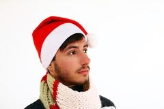 Young man with santa hat isolated on white background Stock Image
