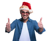 Young man in santa hat making the ok  sign Royalty Free Stock Photos