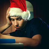 Young Man in Santa Hat sleeping Stock Images