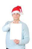 Young man in Santa's hat holding blank card Royalty Free Stock Photos