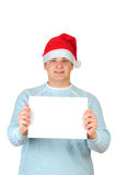 Young man in santa's hat holding empty blank Royalty Free Stock Image