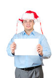 Young man in santa's hat holding empty blank Stock Photography
